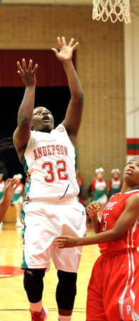 Photo by Chris Martin for The Herald Bulletin.  Anderson's Kenigia Hamilton drives for a layup Tuesday night against Pike at home.