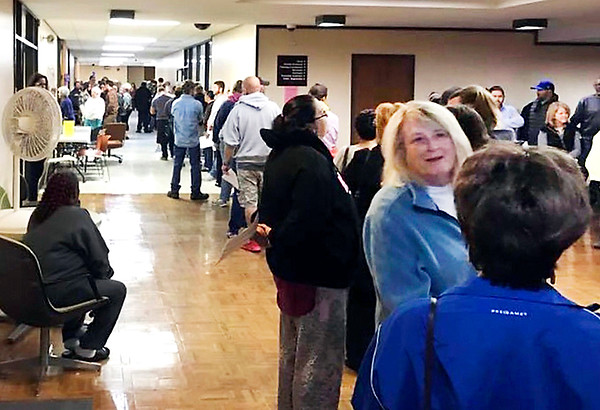 People waited for more than two hours Monday morning to vote early at the Madison County Government Center.