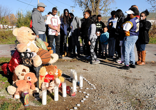 Don Knight | The Herald Bulletin<br /> A prayer walk lead by New Purpose Ministries pastor Darnell Williams prays at a memorial built where Shaolin Newsom was shot and killed in October.