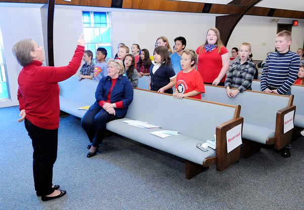 "Don Knight | The Herald Bulletin<br /> Students sing ""God Bless America"" during the Veterans Day program at Anderson Christian School on Friday."