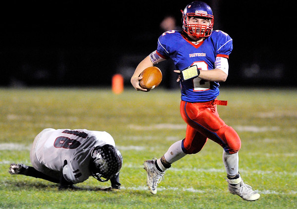 Don Knight   The Herald Bulletin<br /> Elwood quarterback Jake Wilson scrambles and gets away from Eastbrook's Mason Hale during the sectional 36 final on Friday.
