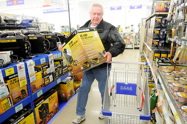 Don Knight   The Herald Bulletin<br /> Jerry Kim loads a welder into his cart at Harbor Freight Tools in Anderson during Black Friday shopping.