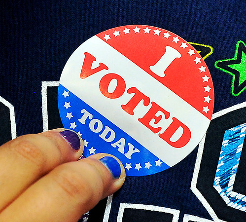 John P. Cleary |  The Herald Bulletin<br /> This Anderson Elementary voter puts on her 'I Voted Today' sticker after casting her ballot in the schools mock election.
