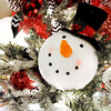 """Don Knight   The Herald Bulletin<br /> Frosty the Snowman pears out from a tree designed by Bekah Snyder Logan and titled """"All Hats Off to Frosty"""" at the Festival of Trees at the Paramount on Saturday."""