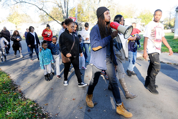 Don Knight | The Herald Bulletin<br /> Tyler Kelley offers a prayer during a walk to the spot where his brother Shaolin Newsom was shot and killed in October. New Purpose Ministries held the prayer walk through the neighborhood on Saturday.