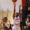 David Humphrey | For The Herald Bulletin<br /> Monica Watkins takes a three point shot for the Lady Lions.