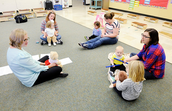 Don Knight | The Herald Bulletin<br /> Edgewood Elementary music teacher Staci Miller teaches a Music Makers class for infants and toddlers. The classes are offered free to the public but call ahead because class size is limited to about 10 students to maximize the learning experience.