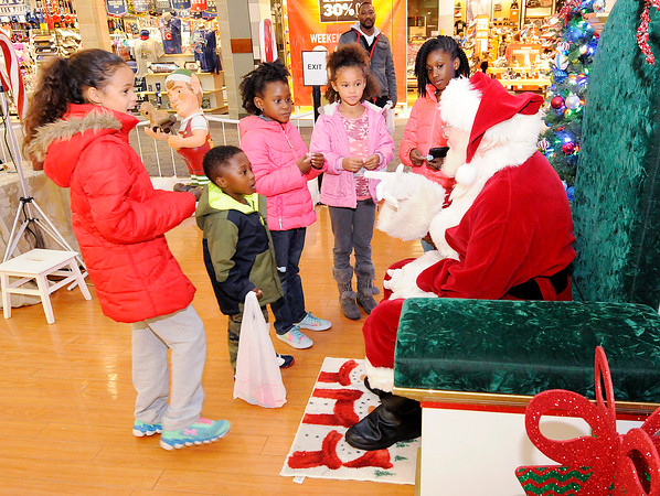 Don Knight | The Herald Bulletin<br /> From left, Amyah Strange, Maddox Gamble, Cloe Hunter, Jayla Moore and Logan Gamble tell Santa what they want for Christmas at the Mounds Mall on Friday. Santa will be at the mall Monday through Friday from 5 to 8 p.m., on Saturdays from Noon to 8 p.m. and on Sundays from 1 to 5 p.m. There will be special hours from the 19th through the 23rd of Noon to 8 p.m. and 11 a.m. to 5 p.m. on Christmas Eve.