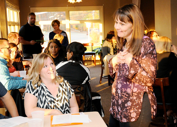 Don Knight | The Herald Bulletin<br /> Anderson Education Foundation board member Andrea Kirkpatrick, right, talks to Jeannette McMahon from Erskine Elementary who received the Lisa McVicker Reading Grant at the Grandview Clubhouse on Wednesday.