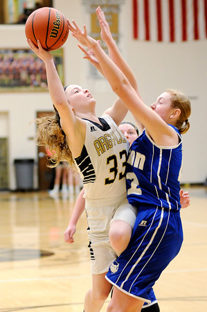 Don Knight | The Herald Bulletin<br /> Madison-Grant's Katelyn Shouse draws a foul from Tipton's Rachel Majors as she drives to the basket at Madison-Grant on Saturday.