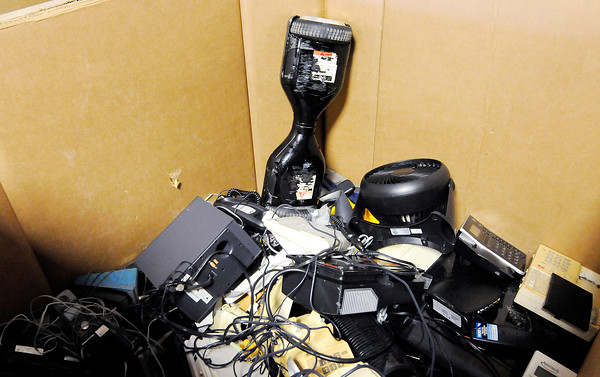 Don Knight | The Herald Bulletin<br /> A box of miscellaneous electronics including a recalled self balancing scooter sits at the Madison County Recycling Center. Electronics are potentially hazardous if dumped in landfills and by law must taken to an authorized disposal site.