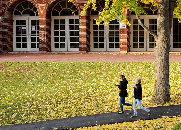 Don Knight   The Herald Bulletin<br /> Students walk through the valley past the Nicholson Library on Friday. The first freeze of the season is forecast for the weekend. This fall has broke the record for the latest freeze.