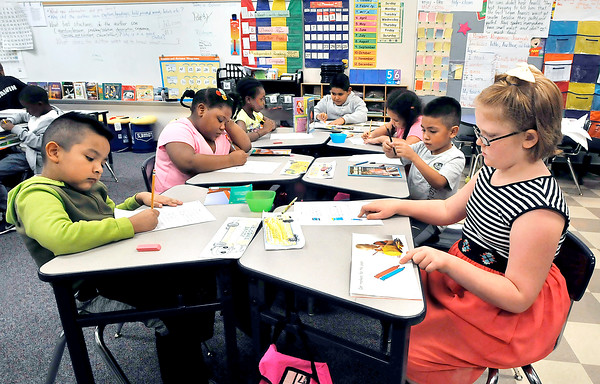 John P. Cleary |  The Herald Bulletin<br /> The students of Jennie Morgan's 2nd grade class at Anderson Elementary School work on their class assignments Thursday.