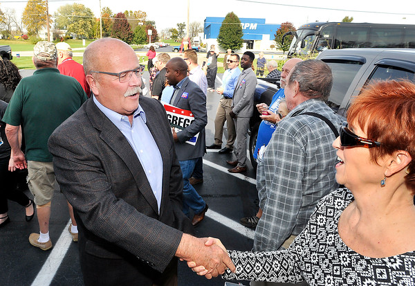 John P. Cleary |  The Herald Bulletin<br /> John Gregg greets folks at Good's Candy Shop Wednesday afternoon during at stop of his John Gregg for Governor campaign bus tour.