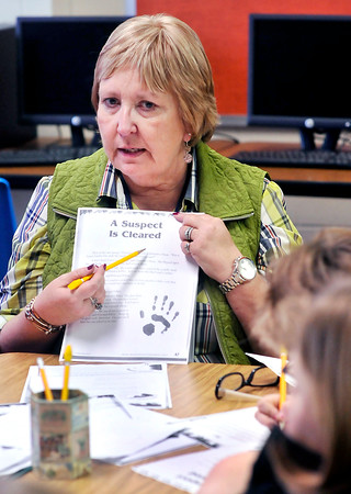 John P. Cleary |  The Herald Bulletin<br /> Elwood Intermediate School teacher Mary Ellen Whitson discusses the days lesson with her students in the Read 180 program.