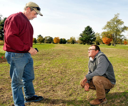 John P. Cleary |  The Herald Bulletin<br /> New owner of Yule Golf Course, Jeff Adams, and his superintendent Clint Martin check out the growth of the newly planted bluegrass along the 18th fairway of the old course.