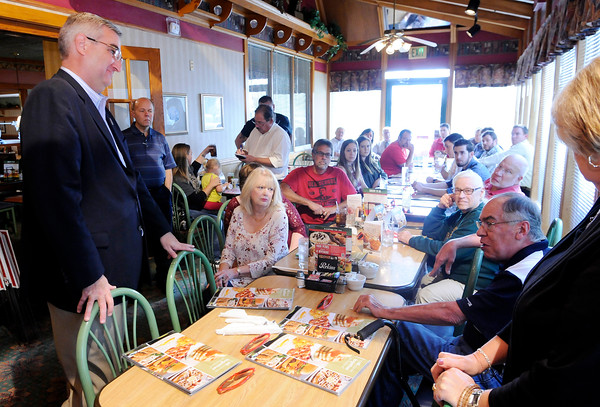 Don Knight | The Herald Bulletin<br /> Republican candidate for governor Eric Holcomb listens to a comment by former state representative Jack Lutz as Holcomb and Suzanne Crouch visit with supporters at the Perkins in Anderson on Wednesday.