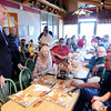 Don Knight   The Herald Bulletin<br /> Republican candidate for governor Eric Holcomb listens to a comment by former state representative Jack Lutz as Holcomb and Suzanne Crouch visit with supporters at the Perkins in Anderson on Wednesday.