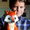 John P. Cleary |  The Herald Bulletin<br /> Tristan Fox, 9, is working to get the red fox named Indiana's state mammal. The closest thing Tristan has to a fox is his fox bank.