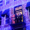 "Don Knight | The Herald Bulletin<br /> Carolers sing ""Little Drummer Boy"" from the balcony of the Elwood Opera House during the 4th Annual ""Light Up the Magic"" on Saturday."