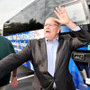 John P. Cleary |  The Herald Bulletin<br /> John Gregg waves at supporters as his campaign bus tour prepares to leave Good's Candy Shop after a campaign meet-and-greet Wednesday.