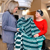 John P. Cleary |  The Herald Bulletin<br /> Renee Creason, systems specialist at St. Vincent Anderson Regional Hospital Cancer Center, gives this Afghan blanket to patient Beverly Fox after her last cancer treatment Monday. Creason's aunt, Kay Smelser, crochets the blankets and donates them for the cancer patients.