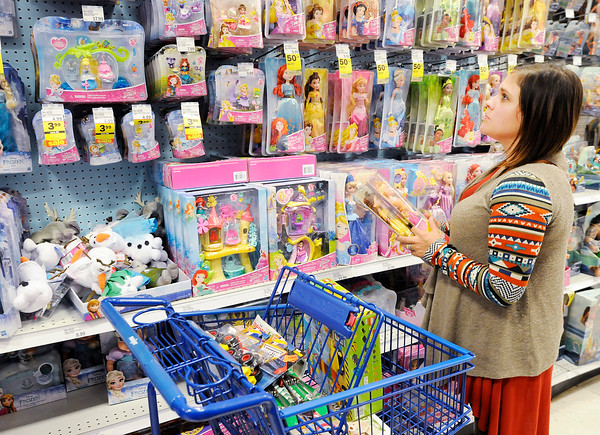 Don Knight   The Herald Bulletin<br /> Nika Hudson looks at Disney Princess dolls on sale for 50 percent off during Black Friday shopping at the Meijer in Anderson. Hudson started shopping Thursday and shopped through the night.