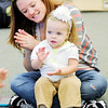 Don Knight | The Herald Bulletin<br /> Meghan Zook and her daughter 16-month old Eliza clap along to the beat during a Music Makers class for infants and toddlers at Edgewood Elementary on Friday.