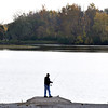 John P. Cleary |  The Herald Bulletin<br /> The evening sky reflecting off the water silhouettes this angler as he fishes off the boat ramp at the north end of Shadyside Lake.