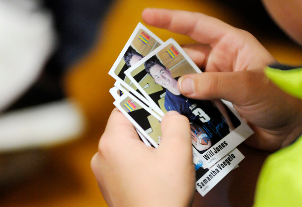 Don Knight | The Herald Bulletin<br /> A student holds his collection of athlete cards during an Athletes of Character event at Lapel Elementary on Friday.