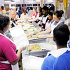 Don Knight | The Herald Bulletin<br /> Volunteers serve up thousands of meals during The Gospel Highlights Radio Broadcast 34th Annual Community Thanksgiving Day Dinner at the Geater Community Center on Thursday.