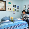 John P. Cleary |  The Herald Bulletin<br /> Tristan Fox, 9, reads about his favorite animals in his bedroom where everything is geared to them.