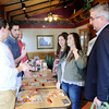 Don Knight | The Herald Bulletin<br /> Republican candidate for governor Eric Holcomb talks to members of Anderson University's chapter of College Republicans at the Perkins in Anderson on Wednesday. Clockwise from left are Keegan Russell, Chandler Clark, Becca Peach and Kaitlyn Ewing.