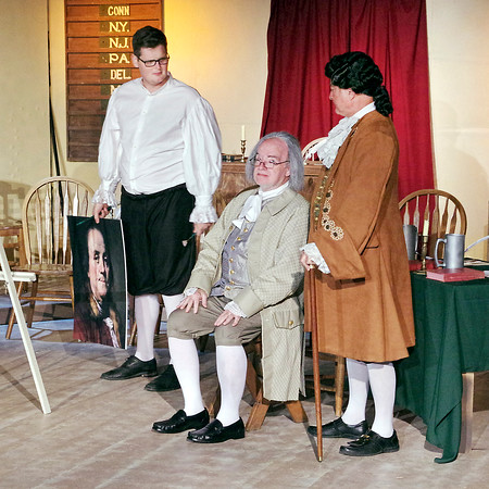 Mark Maynard | for The Herald Bulletin<br /> As his portrait painter (Michael Smith) looks on, Benjamin Franklin (William Malone) trys to convince John Adams (Mak Tumey) that someone other then Adams should champion the idea of independence from England to the Continental Congress.