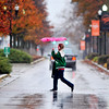 John P. Cleary |  The Herald Bulletin<br /> It was hard trying to stay dry Monday if you spent any time outdoors with the constant rain that fell most of the day, like this AU student crossing University Blvd. with her small, floppy umbrella.