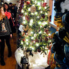 "Don Knight | The Herald Bulletin<br /> Sydney Thompson, 10 looks at a tree titled ""Old Fashioned Christmas"" and designed by Susan Davenport and Susan Lawrence during the Festival of Trees at the Paramount on Saturday. Saturday was the first day the display of trees was open to the general public. It is open today from noon to 5 p.m."