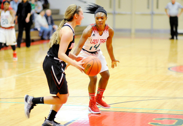 Don Knight   The Herald Bulletin<br /> Anderson's DeeDee Sutton guards Huntington North's Hollyn Anderson on Saturday.