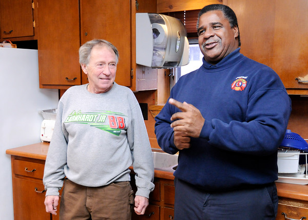 Don Knight | The Herald Bulletin<br /> Phil Rogers talks with retired firefighter Bryce Downey during an open house at Station 2 on Rogers last day before retirement on Thursday.