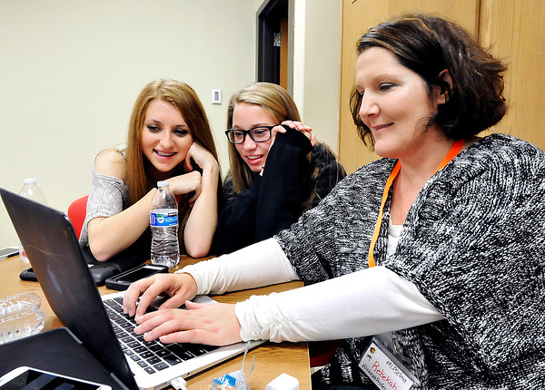 John P. Cleary |  The Herald Bulletin<br /> Wapahani High School sophomores Carlie Boggs, and Lexah Dornick work with Wapahani's tech coach Rebekah Ireland during their breakout session titled: My Oh My! My Maps! at the second annual fall Hoosier Student Digital Leaders summit held at Elwood Jr.-Sr. High School Tuesday.