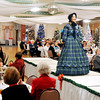 John P. Cleary |  The Herald Bulletin<br /> Sharon McNabney walks the runway as she models this 1860's outfit during a vintage style show presented by the Gruenewald Historic House Tuesday. The vintage clothing was provided by Marion Civic Theatre with the event held at the Paramount Threatre Ballroom.