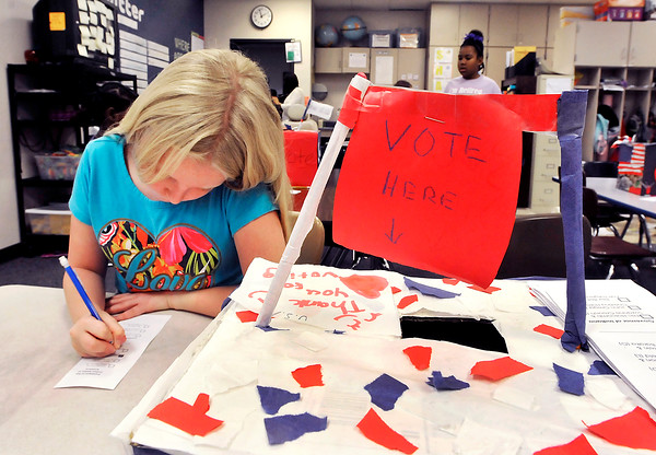 John P. Cleary |  The Herald Bulletin<br /> Anderson Elementary 3th grader Shaylah Adams, 10, fills out her ballot as she votes during the mock election held at the school Nov. 1st.