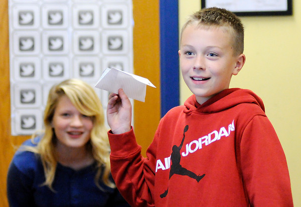 Don Knight   The Herald Bulletin<br /> Gage Spurlin flies a paper airplane he made following an algorithm in John Lambert's STEAM class at Eastside Elementary.