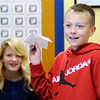 Don Knight | The Herald Bulletin<br /> Gage Spurlin flies a paper airplane he made following an algorithm in John Lambert's STEAM class at Eastside Elementary.