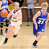 Don Knight | The Herald Bulletin<br /> Madison-Grant's Abbey Gunning brings the ball downcourt as she is chased by Tipton's Taylor Robison as the Argylls hosted the Blue Devils on Saturday.