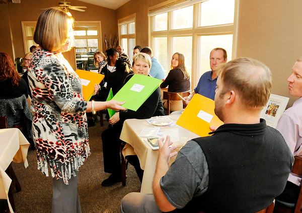 Don Knight | The Herald Bulletin<br /> Anderson Education Foundation Executive Director Kay Bale hands a grant folder to Brandon Bailey from Highland Middle School who received the Stephen Hamer Science Grant at the Grandview Clubhouse on Wednesday.
