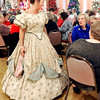 John P. Cleary |  The Herald Bulletin<br /> Angie Davis walks through the crowd as she shows off this 1860's dress during a vintage style show presented by the Gruenewald Historic House Tuesday at the Paramount Threatre Ballroom.