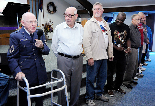 Don Knight | The Herald Bulletin<br /> WWII veteran Earl Lautzenheiser introduces himself during the Veterans Day program at Anderson Christian School on Friday.
