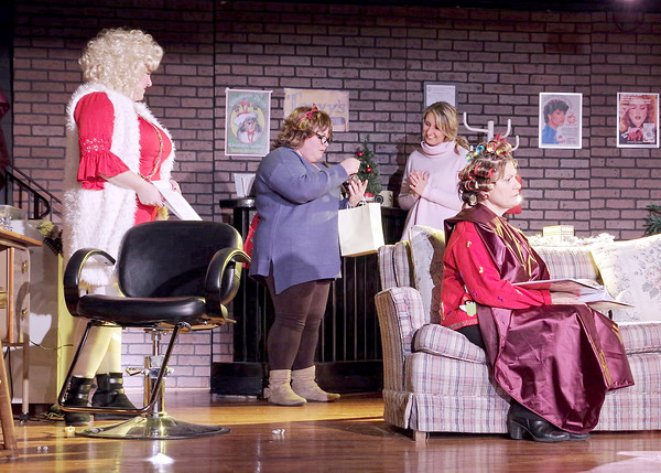 Mark Maynard   For The Herald Bulletin<br /> Truvy (Allison Hughel-Cage), Annelle (KIrby Gilliam) and Shelby (Katherine Jones) look at a new Christmas ornament while M'lynn (Karen Lynn Sipes) worries about her diabetic daughter Shelby's decision to become pregnant.