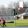 Don Knight | The Herald Bulletin<br /> Caleb Richards, left, and Nathan Ogburn play one on one at the Pulaski Park basketball courts on Tuesday. Unseasonably warm temperatures and sunny skies made Tuesday a great day to get outside.