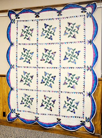 Don Knight | The Herald Bulletin<br /> A floral applique quilt made by Jean Hummer is part of the new quilt display that opened at the Madison County History Center on Friday.